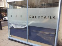 Self-adhesive frosted vinyl - McQuillan Signs, Brighton.
